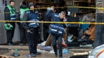 Responders work to clean up the scene of Tuesday's shooting that left multiple people dead at a kosher market on Wednesday Dec. 11, 2019, in Jersey City, N.J. (AP Photo/Kevin Hagen)