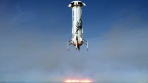 In this image provided by Blue Origin, the New Shepard rocket booster lands near Van Horn, Texas. Blue Origin, Jeff Bezos' space company, has scored another successful spaceflight, when it launched and landed the same rocket for the sixth time Wednesday. (Blue Origin via AP)