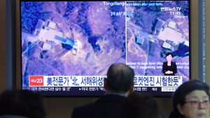 A man watches a TV screen showing an image of a North Korean long-range rocket launch site during a news program at the Seoul Railway Station in Seoul, South Korea, Monday, Dec. 9, 2019. (AP Photo/Ahn Young-joon)