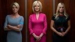 "This image released by Lionsgate shows Charlize Theron, from left, Nicole Kidman and Margot Robbie in a scene from ""Bombshell."" (Hilary B. Gayle/Lionsgate via AP)"