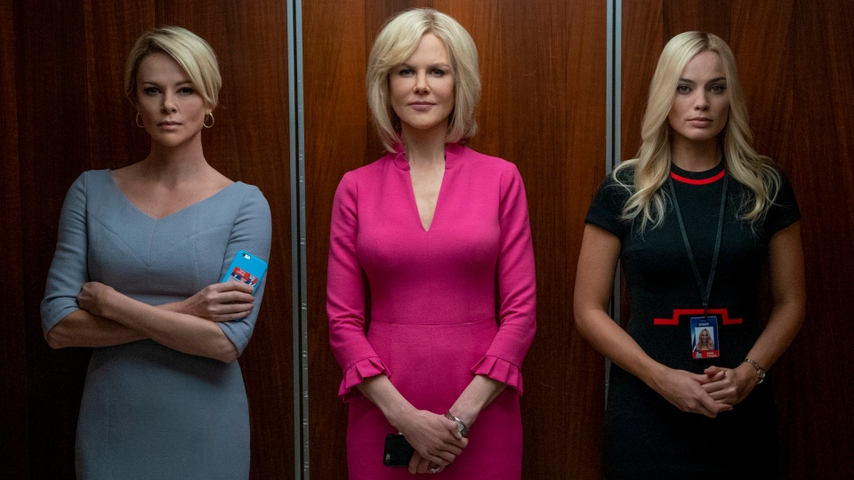 """This image released by Lionsgate shows Charlize Theron, from left, Nicole Kidman and Margot Robbie in a scene from """"Bombshell."""" (Hilary B. Gayle/Lionsgate via AP)"""