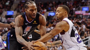 LA Clippers forward Kawhi Leonard (2)and Toronto Raptors guard Norman Powell (24) battle during second half NBA basketball action in Toronto on Wednesday, December 11, 2019. THE CANADIAN PRESS/Nathan Denette