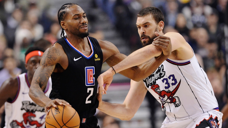 LA Clippers forward Kawhi Leonard (2) protects the ball from Toronto Raptors centre Marc Gasol (33) during first half NBA basketball action in Toronto on Wednesday, December 11, 2019. THE CANADIAN PRESS/Nathan Denette