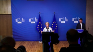 European Commission President Ursula von der Leyen, center, gives a press statement on the European Green Deal at the European Commission headquarters in Brussels, Wednesday, Dec. 11, 2019. (AP Photo/Francisco Seco)