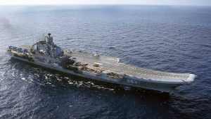 In this 2004 file photo the Admiral Kuznetsov aircraft carrier seen in the Barents Sea, Russia. A fire on Russia's only aircraft carrier injured two service members, Russian military officials said Thursday Dec. 12, 2019. The Admiral Kuznetsov was docked in Murmansk in northern Russia for an upgrade when the fire started amid welding work on Thursday morning. (AP Photo, file)