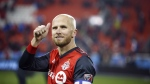 Toronto FC midfielder Michael Bradley (4) gives thumbs up to the crowd following their victory against the Atlanta United during MLS soccer action in Toronto, Sunday, Oct. 28, 2018. Toronto FC has confirmed captain Bradley is returning next season after signing a new deal. THE CANADIAN PRESS/Cole Burston