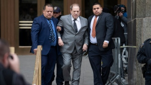 FILE - In this Friday, Dec. 6, 2019, file photo, Harvey Weinstein, center, leaves court following a bail hearing in New York. A lawyer for the Weinstein companies said Thursday, Dec. 12, 2019, that 98 percent of creditors are joining a tentative settlement that includes $25 million for over two dozen actresses and former Weinstein employees who claim they were sexually harassed by Harvey Weinstein. (AP Photo/Mark Lennihan, File)
