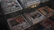 A view of newspapers on sale, with front pages showing the results, a day after the UK General Election, in London, Friday, Dec. 13, 2019. British Prime Minister Boris Johnson says the largest Conservative majority since the 1980s shows that getting Brexit done has now proved to be the will of the British people. (AP Photo/Alberto Pezzali)