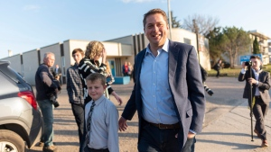 Conservative Party Leader Andrew Scheer leaves a voting station at Our Lady of Peace Parish on Election Day in Regina, Monday, Oct. 21, 2019. Suprise and sadness was some of the reaction heard in Andrew Scheer's Regina riding after his decision to resign as leader of the Conservative Party of Canada. THE CANADIAN PRESS/Michael Bell