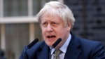 Britain's Prime Minister Boris Johnson speaks outside 10 Downing Street in London on Friday, Dec. 13, 2019. (AP Photo/Matt Dunham)