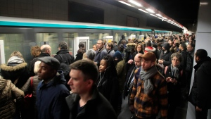 Commuters wait on the the platform of a subway train station Friday, Dec.13, 2019 in Paris. French President Emmanuel Macron suggested Thursday that he was ready to make changes to his plans to overhaul the pension system as a major union warned that nationwide strikes and protests could continue unabated until Christmas. (AP Photo/Michel Euler)