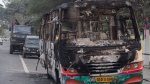 Indian army vehicles are parked behind a bus which was burnt by protesters during a protest against the Citizenship Amendment Bill in Gauhati, India, Friday, Dec. 13, 2019. Japanese Prime Minister Shinzo Abe is postponing a meeting with Prime Minister Narendra Modi in India's northeast. The region has been the site of continuing protests against a new law that grants citizenship to non-Muslims who migrated from neighboring countries. (AP Photo/Anupam Nath)