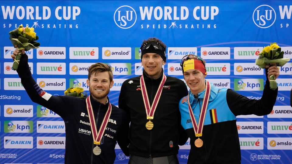 From left, silver medalist Joey Mantia, of the United States, gold medalist Canada's Jordan Belchos and bronze medalist Belgium's Bart Swings pose together during a medal ceremony for the men's mass start race of the speed skating World Cup at the M-Wave in Nagano, Japan, Friday, Dec. 13, 2019. (AP Photo/Toru Hanai)