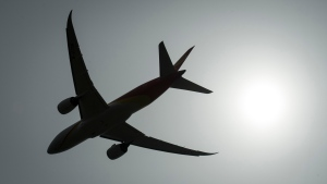 A plane is silhouetted as it takes off from Vancouver International Airport in Richmond, B.C., Monday, May 13, 2019. THE CANADIAN PRESS/Jonathan Hayward
