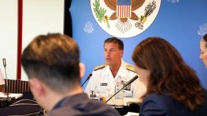 In this photo released by U.S. Embassy in Bangkok, U.S. Navy's Pacific Fleet Commander Adm. John Aquilino talks to reporters during an interview at U.S Embassy in Bangkok, Thailand, Friday, Dec. 13, 2019. (U.S. Embassy in Bangkok via AP)