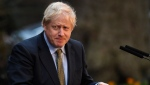 Britain's Prime Minister Boris Johnson after speaking outside 10 Downing Street in London on Friday, Dec. 13, 2019. Boris Johnson's gamble on early elections paid off as voters gave the UK prime minister a commanding majority to take the country out of the European Union by the end of January, a decisive result after more than three years of stalemate over Brexit. (AP Photo/Alberto Pezzali)