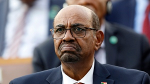 FILE - In this July 9, 2018, file photo, Sudan's President Omar al-Bashir attends a ceremony for Turkey's President Recep Tayyip Erdogan, at the Presidential Palace in Ankara, Turkey. On Saturday, Dec. 14, 2019, a Sudan court convicted al-Bashir of money laundering, sentences him to 2 years in rehabilitation facility. (AP Photo/Burhan Ozbilici, File)