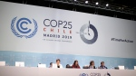 Chilean Environment Minister and chair of COP25 Carolina Schmidt, sitting 2nd left, take part at the COP25 climate talks congress in Madrid, Spain, Saturday, Dec. 14, 2019. The United Nations Secretary-General has warned that failure to tackle global warming could result in economic disaster. (AP Photo/Manu Fernandez)