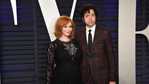 FILE - In this Feb. 24, 2019 file photo, Christina Hendricks, left, and Geoffrey Arend arrive at the Vanity Fair Oscar Party in Beverly Hills, Calif. Hendricks filed for divorce Friday, Dec. 13, from her husband of 10 years, actor Geoffrey Arend. Hendricks filed the marriage dissolution documents in Los Angeles Superior Court, citing irreconcilable differences. (Photo by Evan Agostini/Invision/AP, File)