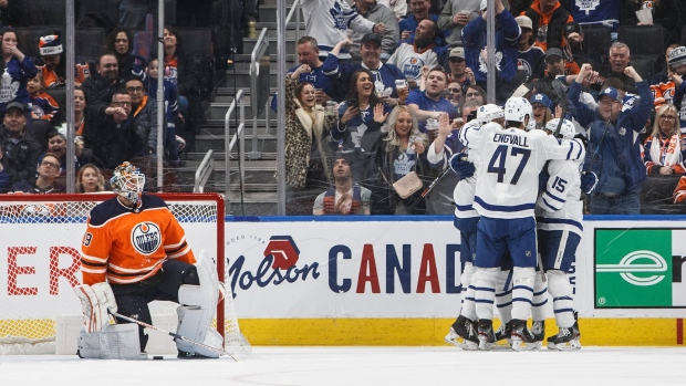Toronto Maple Leafs players celebrate a goal against Edmonton Oilers goalie Mikko Koskinen (19) during second period NHL action in Edmonton, Alta., on Saturday December 14, 2019. THE CANADIAN PRESS/Jason Franson