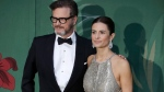 In this file photo dated Sunday, Sept. 22, 2019, British actor Colin Firth and his wife Livia, pose for photographers upon arrival at the Green Carpet Fashion Awards in Milan, Italy. A statement from their publicists says Colin and Italian eco-campaigner and film producer Livia Firth have separated after 22-years of marriage. (AP Photo/Luca Bruno, FILE)