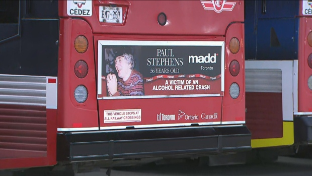 A photo of an impaired driving victim is shown at the rear of a TTC bus. The image is part of a MADD Canada campaign.