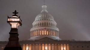 The U.S. Capitol in Washington is shrouded in mist, Friday night, Dec. 13, 2019. This coming week's virtually certain House impeachment of President Donald Trump will underscore how Democrats and Republicans have morphed into fiercely divided camps since lawmakers impeached President Bill Clinton.(AP Photo/J. Scott Applewhite)