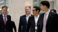 U.S. Special Representative for North Korea Stephen Biegun, center, arrives at Incheon International Airport in Incheon, South Korea, Sunday, Dec. 15, 2019. Biegun arrived in the country on the first leg of his two-stop Asia trip and will meet his counterparts in South Korea and Japan. (AP Photo/Lee Jin-man)