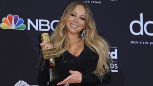 In this May 1, 2019, file photo Mariah Carey poses in the press room with the Icon award at the Billboard Music Awards at the MGM Grand Garden Arena in Las Vegas. (Photo by Richard Shotwell/Invision/AP, File)