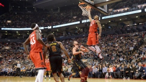 Toronto Raptors guard Norman Powell (24) slam dunks the ball past Cleveland Cavaliers forward Kevin Love (0) as guard Collin Sexton (2) and Raptors forward Pascal Siakam (43) look on during second half NBA basketball action in Toronto on Monday, December 16, 2019. THE CANADIAN PRESS/Nathan Denette