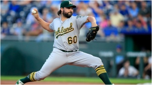 Oakland Athletics starting pitcher Tanner Roark delivers to a Kansas City Royals batter during the first inning of a baseball game at Kauffman Stadium in Kansas City, Mo., Wednesday, Aug. 28, 2019. Right-hander Tanner Roark and the Toronto Blue Jays have agreed to a $24 million, two-year contract, a person with knowledge of the deal told The Associated Press on Wednesday. THE CANADIAN PRESS/AP, Orlin Wagner