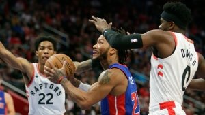 Detroit Pistons guard Derrick Rose (25) drives to the basket against Toronto Raptors guards Patrick McCaw (22) and Terence Davis (0) during the first half of an NBA basketball game Wednesday, Dec. 18, 2019, in Detroit. (AP Photo/Duane Burleson)