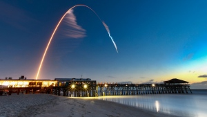 A United Launch Alliance Atlas V rocket carrying the Boeing Starliner crew capsule on an Orbital Flight Test to the International Space Station lifts off from Space Launch Complex 41 at Cape Canaveral Air Force station, Friday, Dec. 20, 2019, in this four minute time exposure of the launch with the Cocoa Beach, Fla., Pier in the foreground. (Malcolm Denemark/Florida Today via AP)