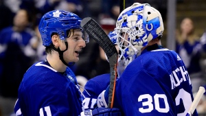 Toronto Maple Leafs goaltender Michael Hutchinson (30) is congratulated by teammate Zach Hyman (11) following third period NHL hockey action against the Detroit Red Wings, in Toronto, Saturday, Dec. 21, 2019. THE CANADIAN PRESS/Frank Gunn