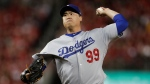 FILE - In this Oct. 6, 2019, file photo, Los Angeles Dodgers starting pitcher Hyun-Jin Ryu throws to a Washington Nationals batter during the first inning in Game 3 of a baseball National League Division Series in Washington. (AP Photo/Julio Cortez, File)
