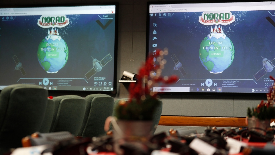 Monitors are illuminated in the NORAD Tracks Santa center at Peterson Air Force Base, Monday, Dec. 23, 2019, in Colorado Springs, Colo. More than 1,500 volunteers will answer an estimated 140,000 telephone calls from children and their parents who will be checking on the whereabouts of Santa Clau on Christmas Eve. (AP Photo/David Zalubowski)