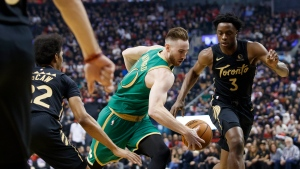 Boston Celtics forward Gordon Hayward (20) drives to the net as Toronto Raptors forward OG Anunoby (3) looks on during first half NBA basketball action in Toronto, Wednesday, Dec. 25, 2019. THE CANADIAN PRESS/Cole Burston