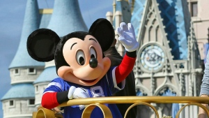 In this Feb. 4, 2019, file photo, Mickey Mouse celebrates the Super Bowl winning team, the New England Patriots, during the Super Bowl victory parade in the Magic Kingdom at Walt Disney World in Lake Buena Vista, Fla. (Joe Burbank/Orlando Sentinel via AP, File)