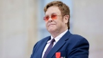 Sir Elton John listens in courtyard of the presidential Elysee Palace in Paris, Friday, June 21, 2019. (AP Photo/Lewis Joly, Pool)