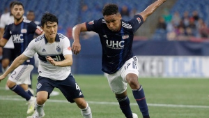 Juan Agudelo is shown in this Wednesday, July 17, 2019 file photo with Vancouver Whitecaps' Hwang In-Beom (left) in Foxborough, Mass. THE CANADIAN PRESS/AP-Steven Senne