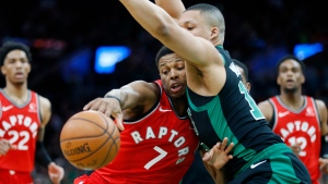 Boston Celtics' Grant Williams (12) defends against Toronto Raptors' Kyle Lowry (7) during the second half on an NBA basketball game in Boston, Saturday, Dec. 28, 2019. (AP Photo/Michael Dwyer)
