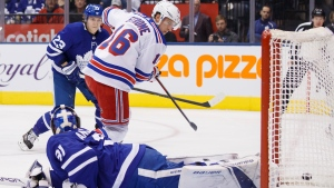 New York Rangers centre Ryan Strome (16) buries a puck behind Toronto Maple Leafs goaltender Frederik Andersen (31) during first period NHL hockey action in Toronto, Saturday, Dec. 28, 2019. THE CANADIAN PRESS/Cole Burston