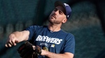 Milwaukee Brewers second baseman Travis Shaw warms up before a baseball game against the Colorado Rockies, Saturday, Sept. 28, 2019, in Denver. (AP Photo/David Zalubowski)