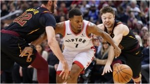 Toronto Raptors Kyle Lowry (7) battles Cleveland Cavaliers Larry Nance Jr. (22) and his teammate Matthew Dellavedova (18) for control of the ball during second half NBA basketball action in Toronto on Tuesday, Dec. 31, 2019. THE CANADIAN PRESS/Hans Deryk