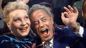Toronto Mayor re-elect Mel Lastman (right) celebrates his victory with wife Marilyn in the Toronto Municipal election Monday November 13, 2000. (CP PHOTO/Kevin Frayer)