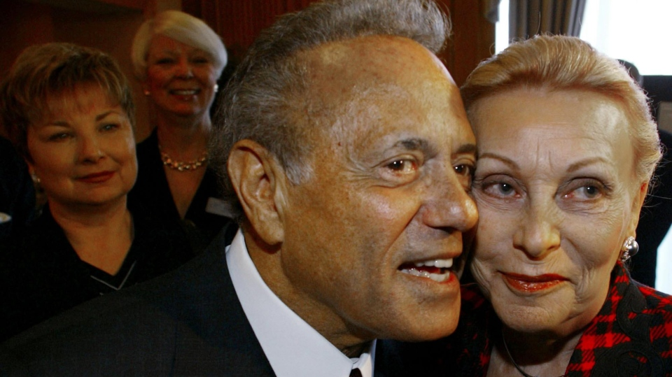 Toronto Mayor Mel Lastman and wife Marilyn (right) wait to enter a luncheon in Toronto Tuesday January 14, 2003. (CP PHOTO/Kevin Frayer)