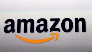 FILE - This Sept. 6, 2012, file photo, shows the Amazon logo in Santa Monica, Calif. Amazon employees say that the company has threatened to fire some workers for publicly pushing the company to do more to combat climate change. (AP Photo/Reed Saxon, File)