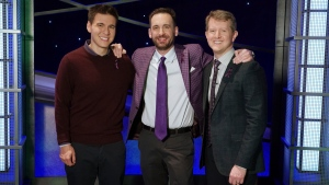 "In this image released by ABC, contestants, from left, James Holzhauer, Brad Rutter and Ken Jennings appear on the set of ""Jeopardy!"" in Los Angeles. (Eric McCandless/ABC via AP)"