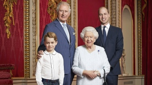 In this handout photo provided by Buckingham Palace and taken Wednesday Dec. 18, 2019, Britain's Queen Elizabeth, Prince Charles, Prince William and Prince George pose for a photo to mark the start of the new decade in the Throne Room of Buckingham Palace, London. (Ranald Mackechnie/Buckingham Palace via AP)