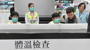 In this Friday, Jan. 3, 2020, photo Hong Kong Chief Executive Carrie Lam, second from right, accompanied by Secretary for Food and Health, Prof. Sophia Chan, right, reviews the health surveillance measures at West Kowloon Station in Hong Kong. (Hong Kong Government Information Service via AP)